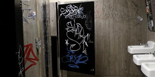 graffiti-filled Brooklyn courthouse bathroom